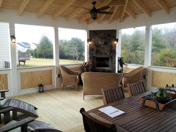 Screened porch designs contractors sunburst construction for Screened porch fireplace designs