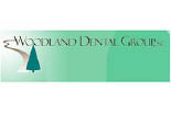 WOODLAND DENTAL logo