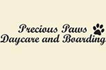 PRECIOUS PAWS DAYCARE & BOARDING logo