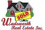 WADSWORTH REAL ESTATE logo