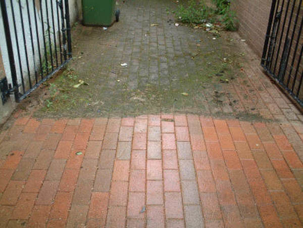 Pressure washing brick before and after