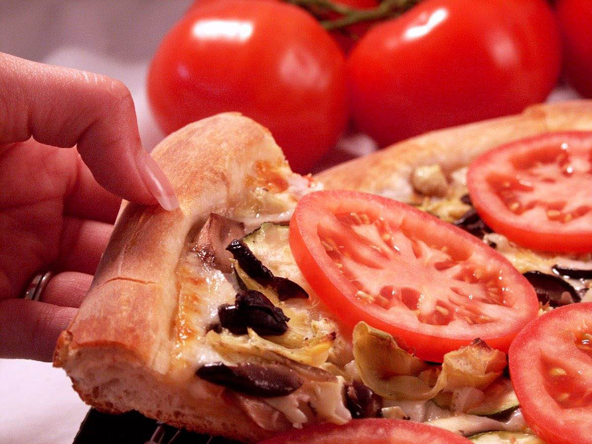 Hand tossed pizza with fresh ingredients at Melo's Danville, CA