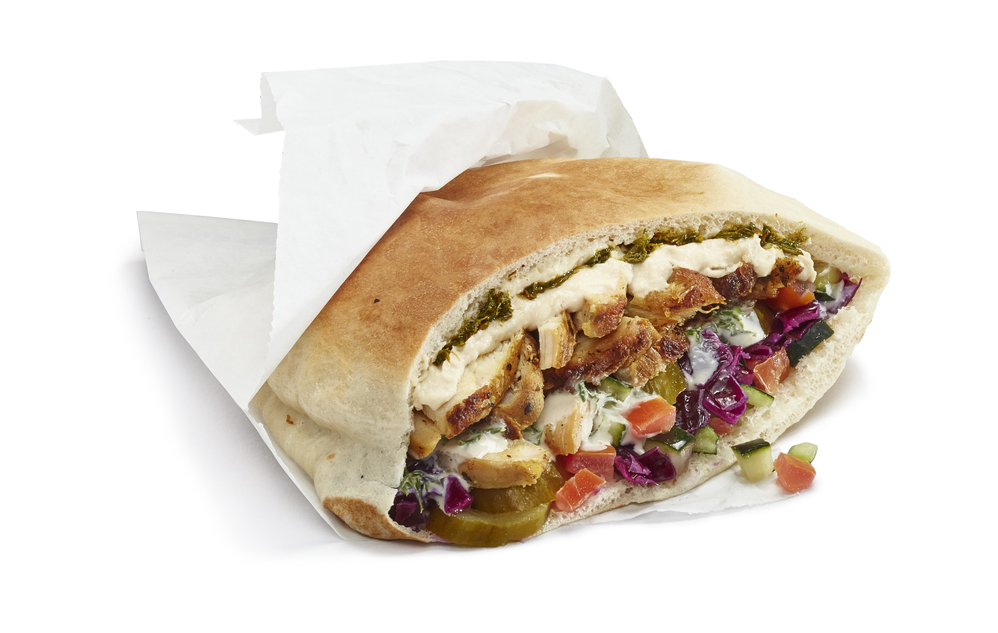 Half a pita with chicken, shwarma and more