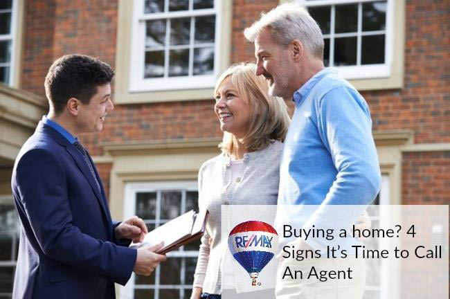 Remax Choice Realty, Elderly photo of couple buying a house.