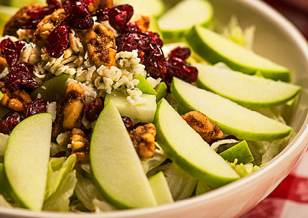 Our dishes are served family-style, meant to be shared by the entire table..  Granny Smith apples, spiced walnuts, dried cranberries and Gorgonzola tossed with mixed lettuce in our signature Italian vinaigrette