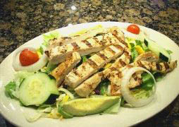 Healthy grilled chicken and fresh avocados