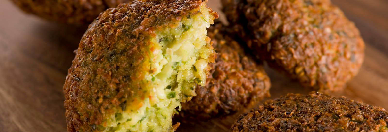 Mediterranean Cuisine - Falafel perfectly seasoned with spices and herbs banner
