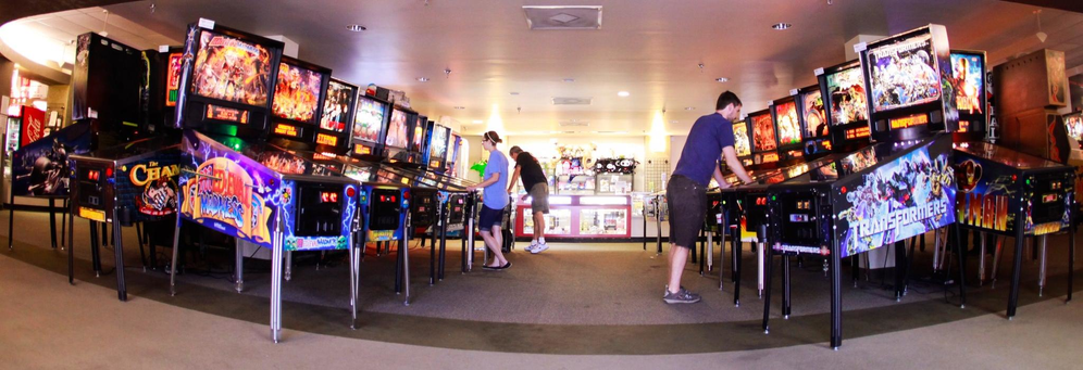 kids & adults playing pinball machines