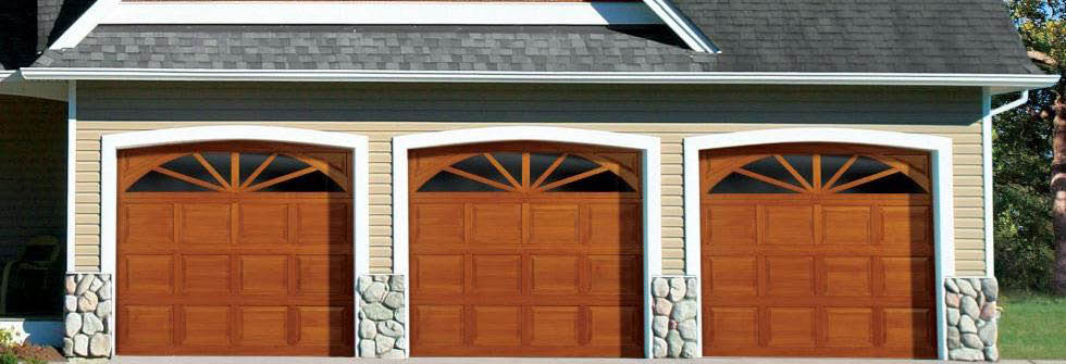 Triple garage doors with arched windows banner
