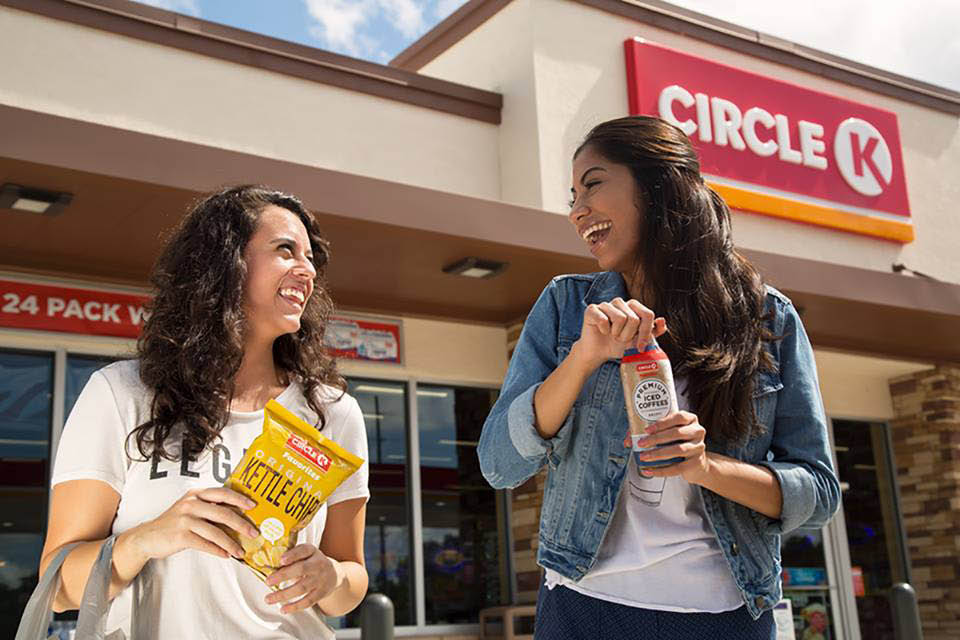 CIRCLE K  women coming out of Circle K with snacks, chips, coffee photo