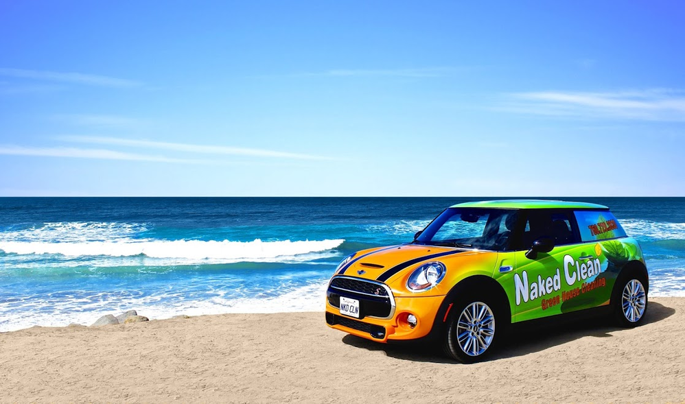 multi-colored car on the beach; Naked Clean promotional vehicle; San Diego County, CA