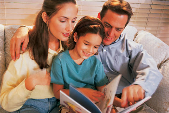 photo of family reading a book