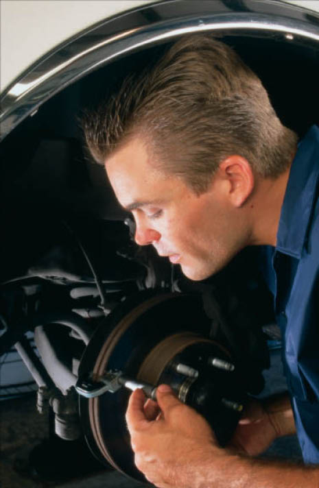 experienced technician working to fix a car in IL