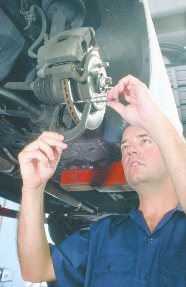 Picture of mechanic fixing car at White Lake Oil Change in White Lake
