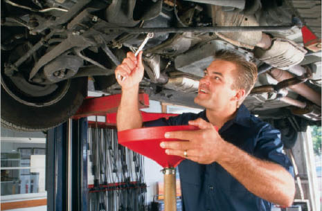 Certified mechanic performing an oil change near Creston, CA