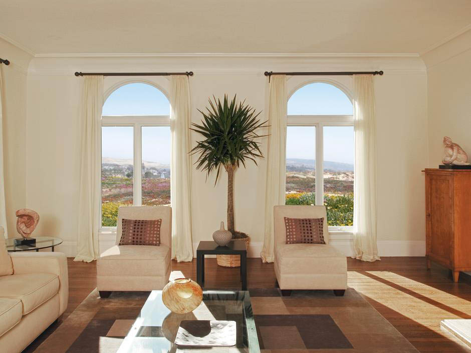 Living room windows bring the outdoors, in