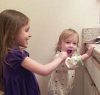 kids brushing teeth; pediatric dentistry of haslet