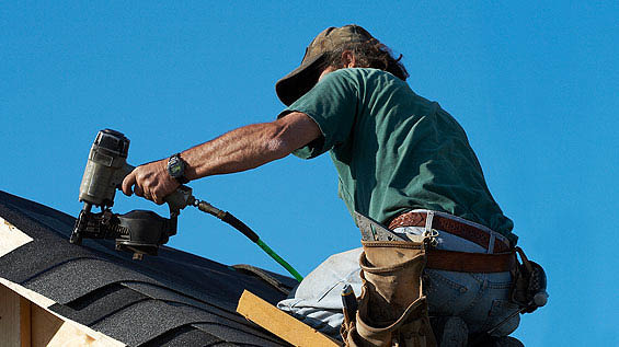WEATHERPROOF ROOFING COMPANY, MAN FIXING ROOF