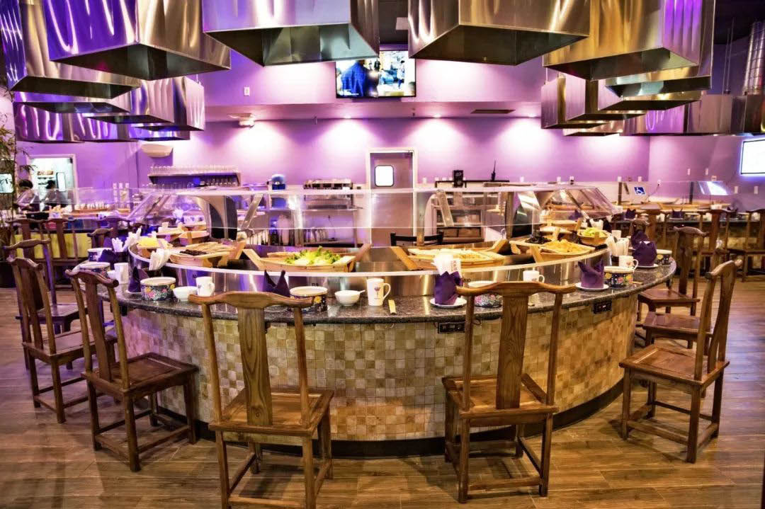 Large hot pot table with buffet food