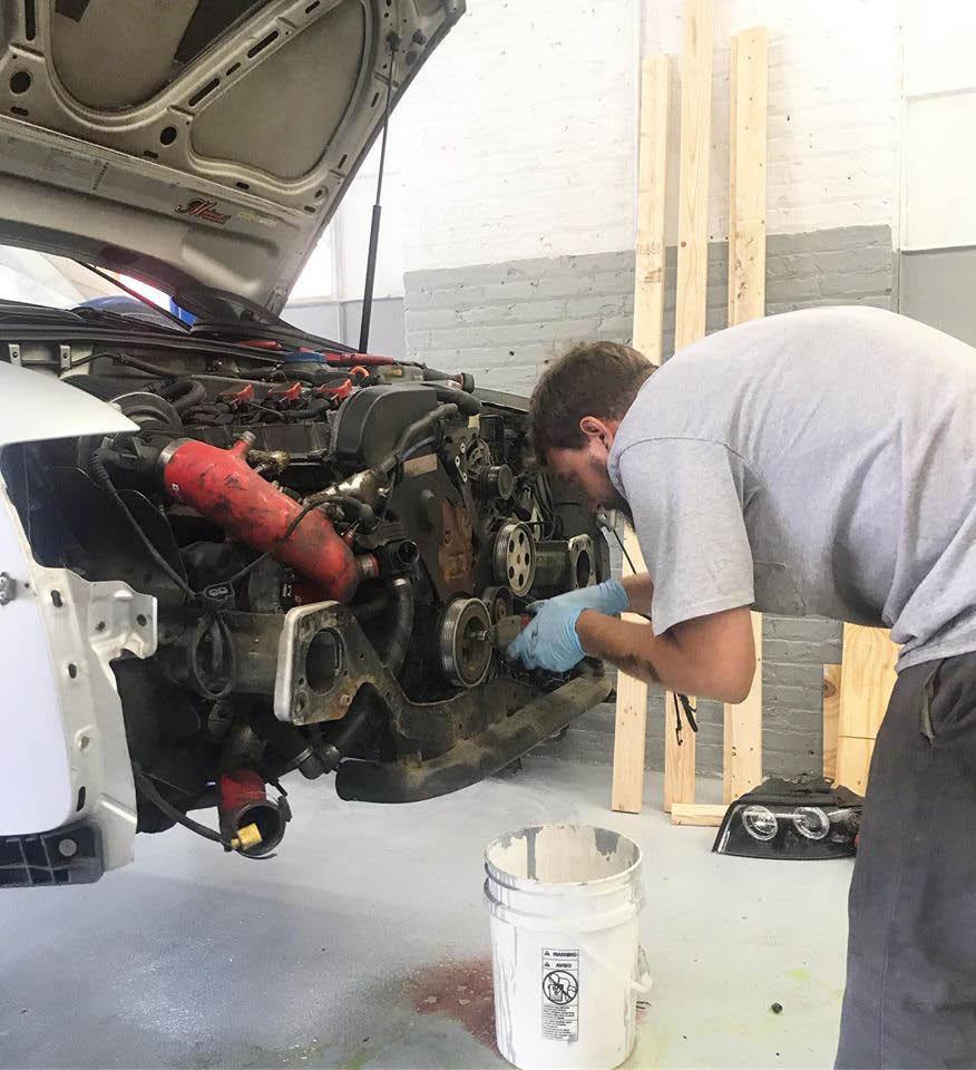 mechanic doing engine work