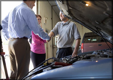 smog check technician with customers at Expert Tune and Smog, Castro Valley