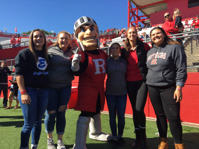 Bianca Vozenilek (second from left)  and Christine Malito (far left) for committing to Rutgers University starting in fall of 2017