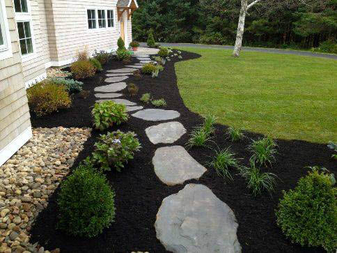landscaping with stones and dark mulch