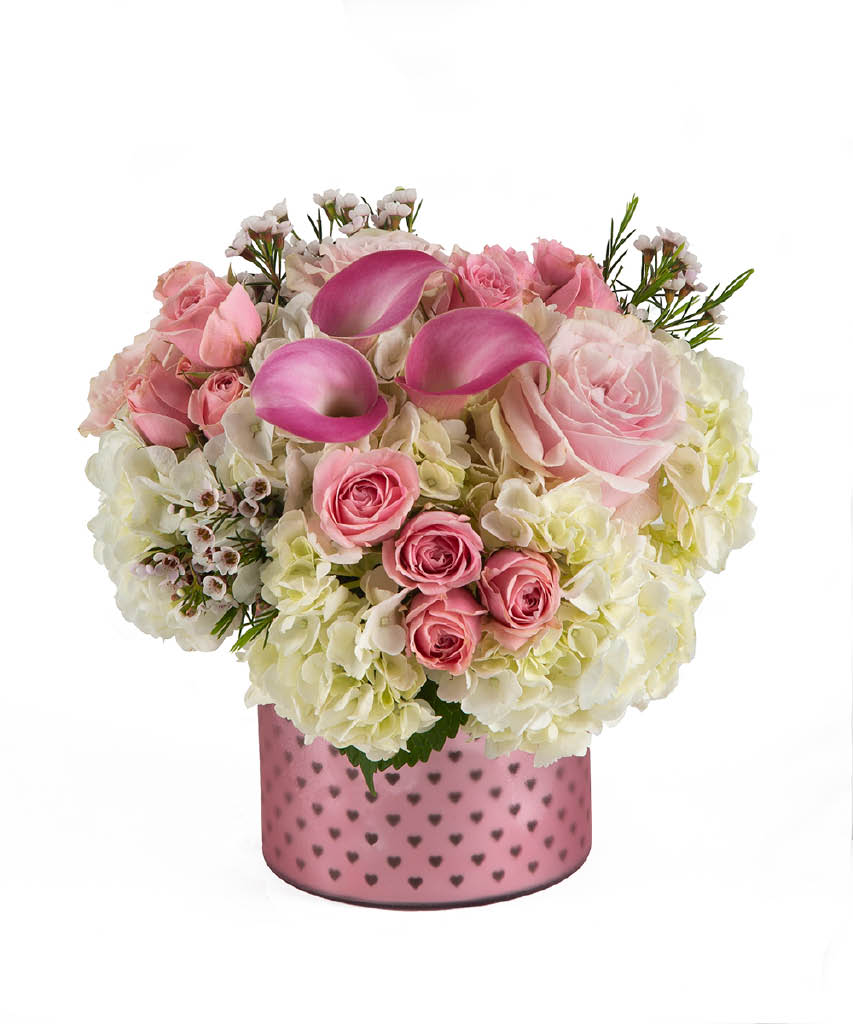 pink and white flowers in cute vase