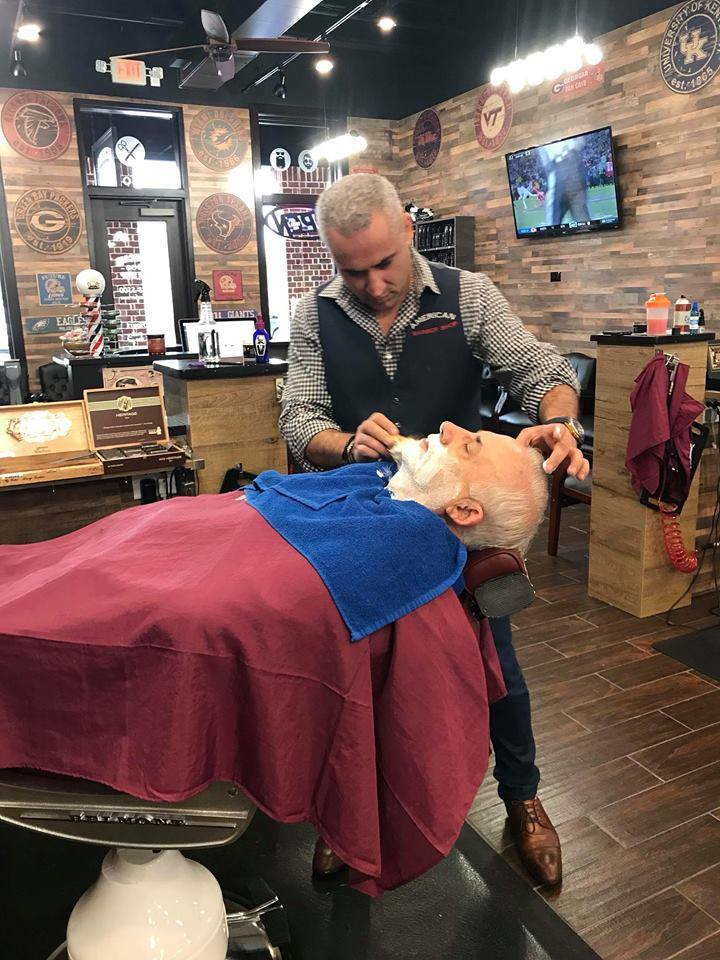 Getting a shave at American Barber Shop