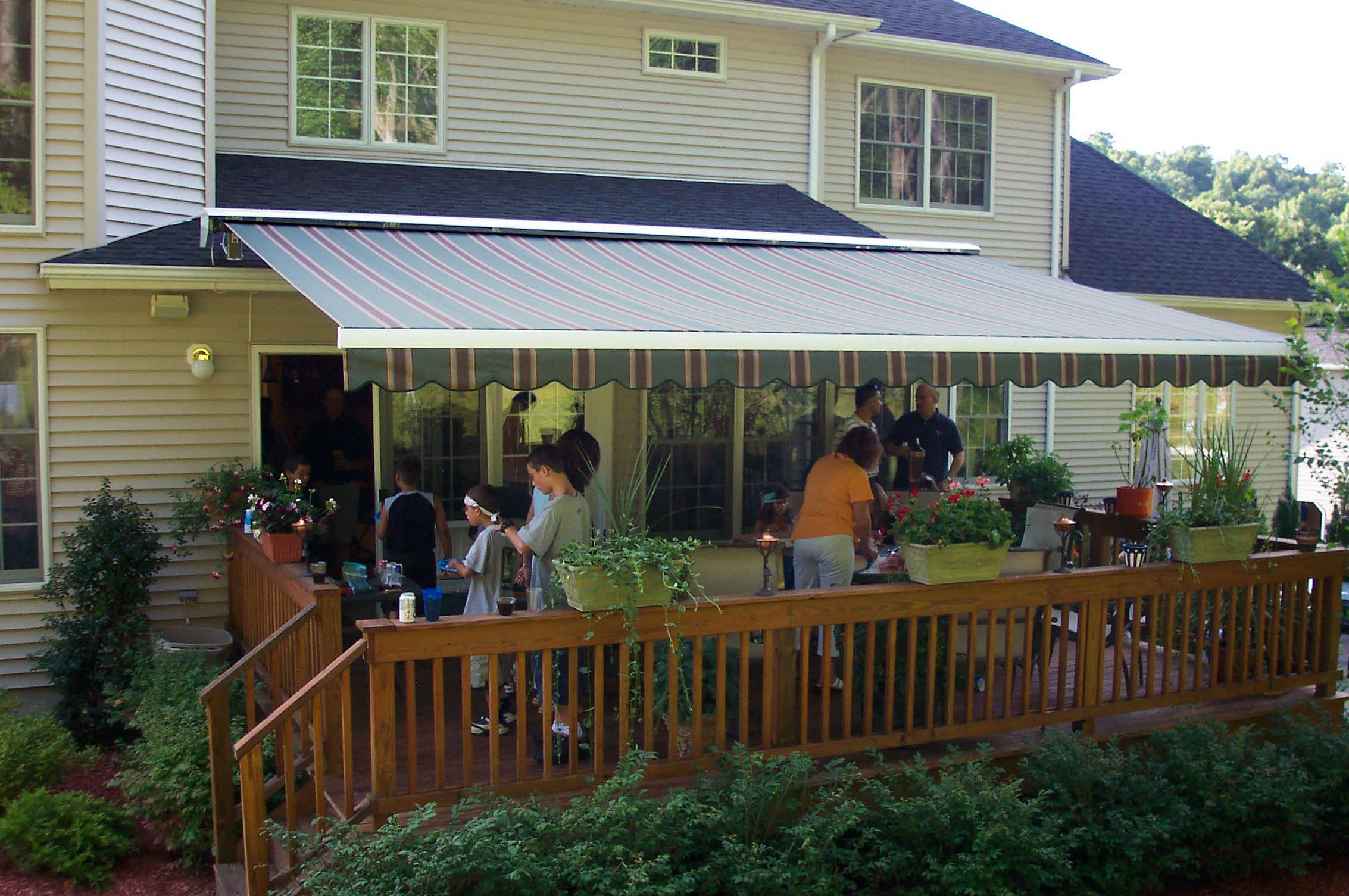 Enjoying a party on the back porch covered with an awning