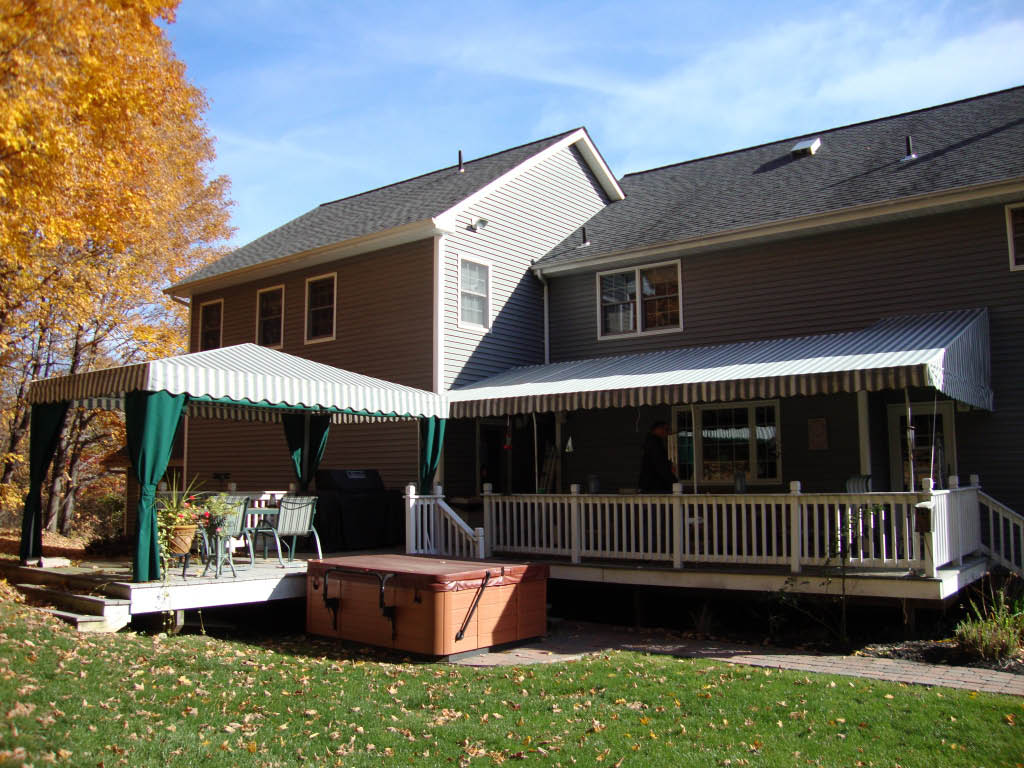 Back porch and deck covered with two styles of coordinated awning