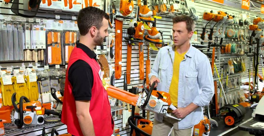 Friendly Ace Hardware employee helping a customer with questions about a STIHL chainsaw - Ace Hardware of Silver Lake, WA