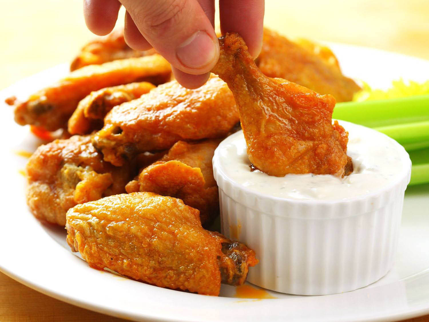 Chicken wings served with dressing