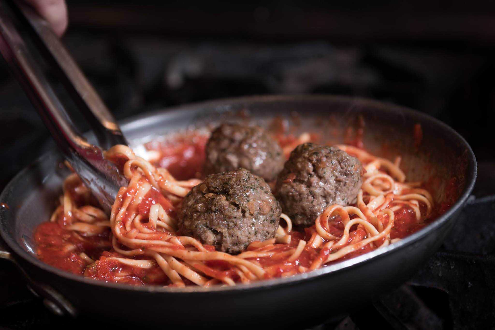 Spaghetti and sauce served with meatballs