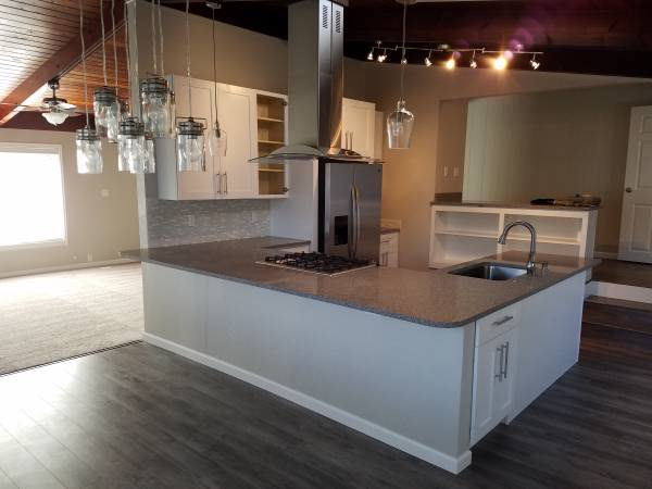 Beautiful kitchen remodel - gorgeous new flooring - flooring stores near me - All Floors and Interiors in Puyallup, WA