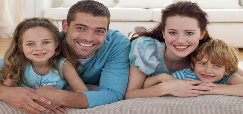 Happy family - comfortable family with a heating and air conditioning system installed by All Season Inc. - Tacoma, WA