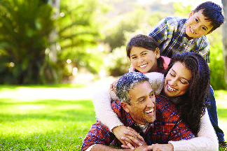 family smiling to show off newly cleaned teeth