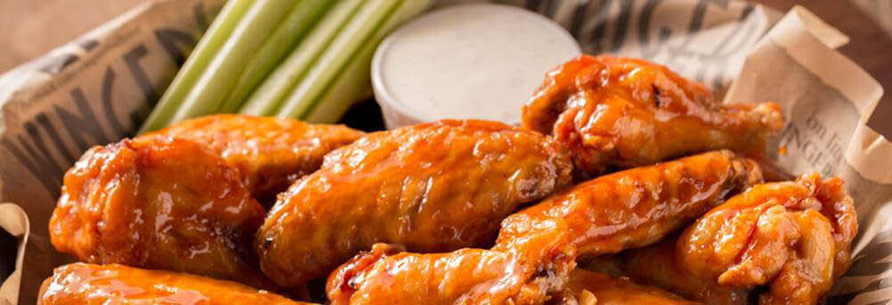 Buffalo Wings, Ranch dressing and Celery.
