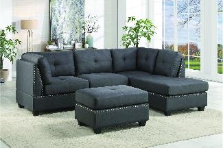studded black sofa in Arian Furniture showroom