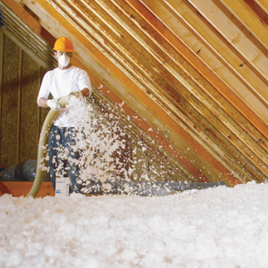 Attic Perfect technician using blown-in insulation