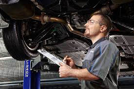 local mechanic performing a vehicle inspection