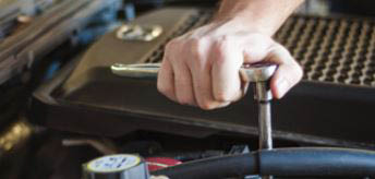 photo of mechanic's hand working on engine at Automotive Physicians in Shelby Twp, MI