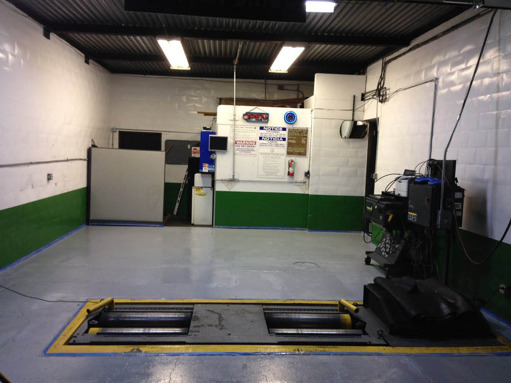 State of the art automotive bay at Bayfair Smog in San Leandro, CA. California certification smog test center. Star-certified
