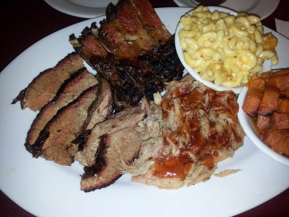 Smoked brisket, ribs and pulled pork dinner