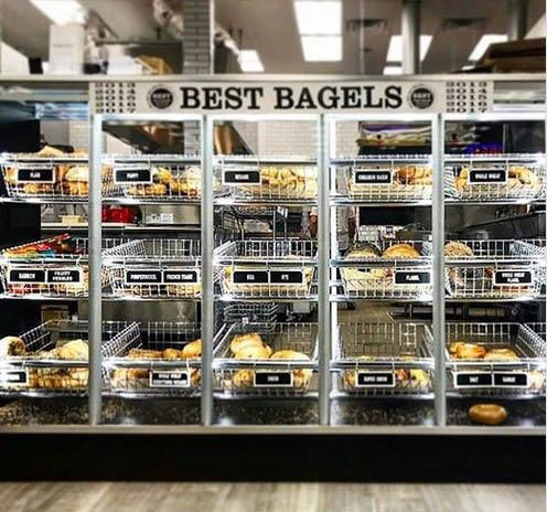 Freshly baked bagels in bread trays