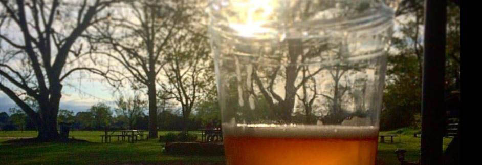 A frosty cold brew and oh, that sunset view - Murdoch's Backyard Pub banner