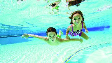 Kids in clean swimming pool