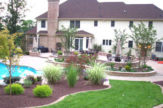 Landscape design service work done on New Jersey home with grass, pool and beautiful p