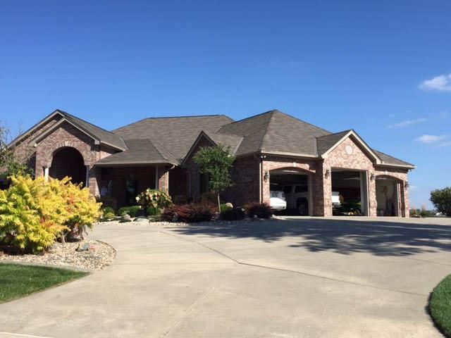 Western Iowa seamless gutters & asphalt roofing services