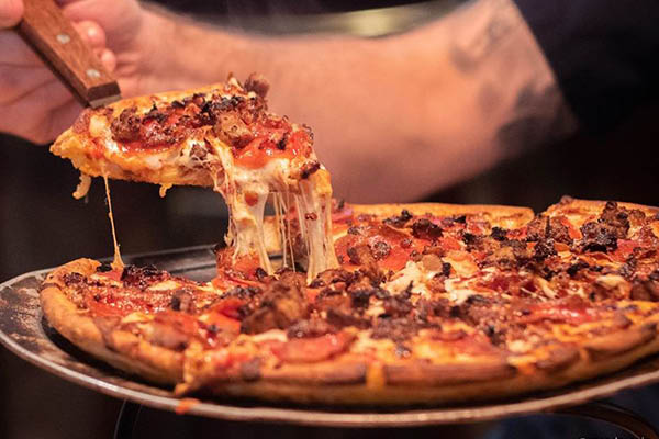 Hot and fresh specialty pizza
